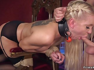 Blond Hair Lady in St Andrews cross bondage screwed