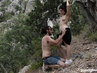 Brunette short haired teen Ole Nina fucks her man outdoors