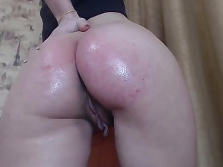 Sexy tattooed chick shows pussy and squirts big all over the place