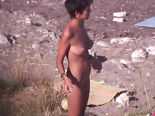 nude circus performer on the beach. spy