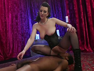 MILF mistress Cherry Torn sits on a black guy's face and pegs him