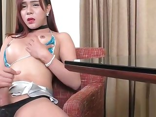 Thai ladyboy Plam masturbates her cock