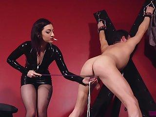 Smoking mistress ass fucks the man in a brutal sex play