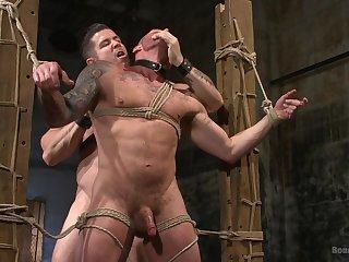 Extreme gay porn in bondage scenes for two bareback hunks