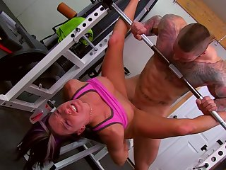 Muscular man fucks hard working babe down at the gym