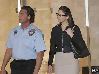 Office worker Anna Morna with glasses gets fucked by a security officer