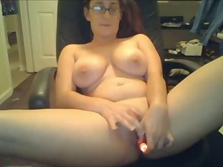 Lovely nerdy webcam whore with big tits uses a dildo for her wet pussy
