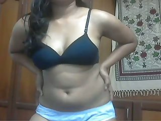 Ardent black head from India stripteases and flashes her boobs
