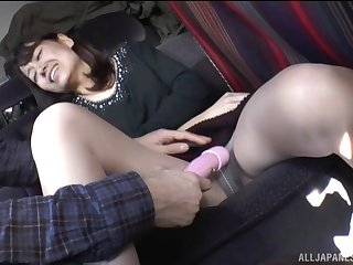 Brunette Japanese mature MILF teased with toys in a car