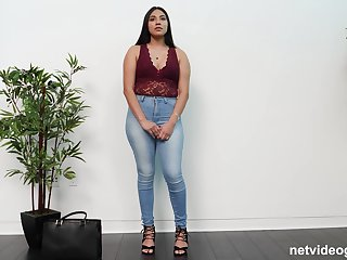 Chubby ebony babe Layloni takes off her clothes on the casting couch